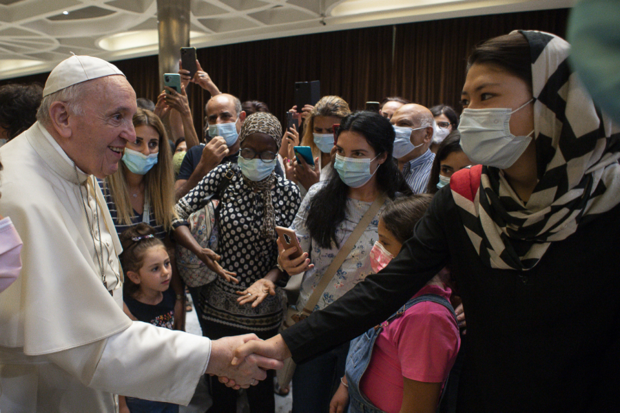 Pope Francis greets Afghan refugees after Vatican documentary screening